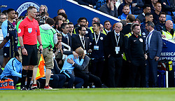 Manchester City manager Pep Guardiola (right) celebrates winning the title in the dugout during the Premier League match at the AMEX Stadium, Brighton.