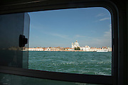 Looking across the Canale della Giudecca from a water taxi. Venice, Italy, Europe