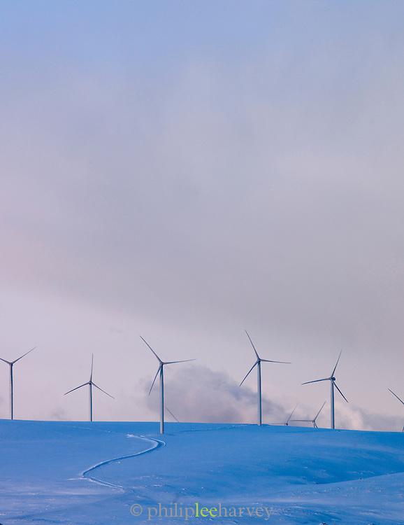 Windfarms on the snowy hillsides in Finnmark region, northern Norway