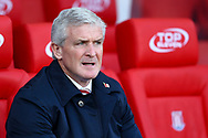 Stoke City Manager Mark Hughes looks on from the dugout. Premier league match, Stoke City v Leicester City at the Bet365 Stadium in Stoke on Trent, Staffs on Saturday 4th November 2017.<br /> pic by Chris Stading, Andrew Orchard sports photography.