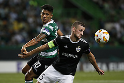 September 20, 2018 - Lisbon, Portugal - Maksim Medvedev of Qarabag FK (R) vies for the ball with Fredy Montero of Sporting (L)  during Europa League 2018/19 match between Sporting CP vs Qarabagh FK, in Lisbon, on September 20, 2018. (Credit Image: © Carlos Palma/NurPhoto/ZUMA Press)