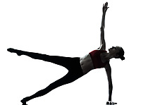 one caucasian woman exercising yoga in silhouette studio isolated on white background