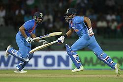 March 14, 2018 - Colombo, Sri Lanka - Indian cricketers Rohit Sharma and Suresh Raina run between the wickets during the 5th Twenty-20 cricket match of NIDAHAS Trophy between Bangladesh and India at R Premadasa cricket ground, Colombo, Sri Lanka on Wednesday 14 March 2018. (Credit Image: © Tharaka Basnayaka/NurPhoto via ZUMA Press)