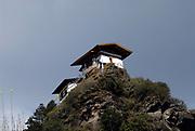 Pinnacle top houses with prayerflags near the Paro Taktsang Goemba, monastery, know as the  Tigers Nest.  Paro Taktsang Bhutan, Druk Yul. 11November 2007