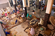 An elevated view of one of the areas used as kitchen to prepare chapatis, the main bread used in north Indian meals. 5 tonnes of wheat are used everyday to feed an average of 50.000 people.