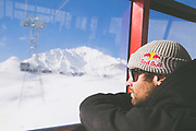 Billy Morgan inside a gondola on 05th May 2017 in Corvatsch, Switzerland. Corvatsch is a mountain in the Bernina Range of the Alps, overlooking Lake Sils and Lake Silvaplana in the Engadin region of the canton of Graubünden.