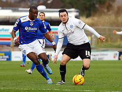 Peterborough United's Lee Tomlin in action with Oldham Athletic's Genserix Kusunga - Photo mandatory by-line: Joe Dent/JMP - Tel: Mobile: 07966 386802 25/01/2014 - SPORT - FOOTBALL - Boundary Park - Oldham - Oldham Athletic v Peterborough United - Sky Bet League One
