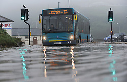 © Licensed to London News Pictures. 30/05/2013<br /> <br /> Saltburn, Cleveland, United Kingdom<br /> <br /> A bus driver makes his way along a flooded road during his journey as heavy overnight rain causes flooding in Saltburn on the A174 coast road near to the Ship Inn on the seafront in the town.<br /> <br /> Photo credit : Ian Forsyth/LNP