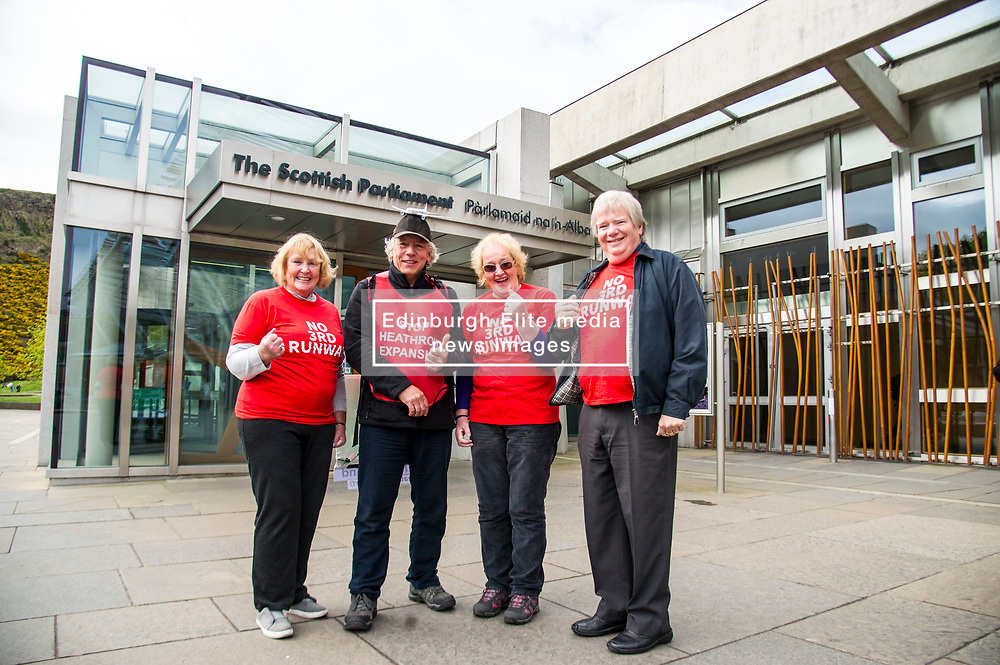 Pictured: Julia Ainsley,  Veronica Rumsey and Phil Rumsey from Richmond joined Neil Keveren outside the Scottish Parliament<br /> <br /> Anti-Heathrow third runway campaigner Neil Keveren, 50, arrives outside the Scottish Parliament after walking nearly 400 miles in protest at SNP backing for a third runway at the London airport. Neil walked on average 20 miles a day since 4 April with his support van givimg him a target to aim for each day.  Some of the residents on the flight path for the new runway have been there for over 40 years and many for all of their lives.  Flights arrive every three minutes between 4 and 5 am with the frequency increasing to every 90 seconds after 5am.<br /> Ger Harley | EEm 27 April 2017