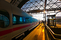 Passengers arrive at the train station at Dresden after sunrise, Saxony, Germany