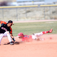 A throw from home base misses Gallup Bengal Seth Manuelito (5)  as Grants Pirate Ronnie Gonzalez (3) slides at Gallup High School Tuesday.