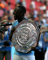 Manchester City's Benjamin Mendy celebrates with the Community Shield at full time