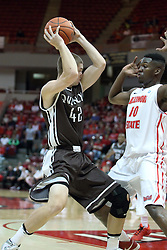 03 November 2013:  Evan McGaughey looks for a way past John Jones during an mens exhibition basketball game between the Quincy Hawks and the Illinois State Redbirds in Redbird Arena, Normal IL