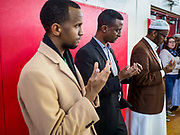 16 MARCH 2019 - BLOOMINGTON, MINNESOTA, USA: Somali-American men pray at Dar al Farooq Center in Bloomington. An interdenominational crowd of about 1,000 people came to the center to protest white supremacy and religious intolerance and to support Muslims in New Zealand who were massacred by a white supremacist Friday. The Twin Cities has a large Muslim community following decades of Somali immigration to Minnesota. There are about 45,000 people of Somali descent in the Twin Cities.    PHOTO BY JACK KURTZ