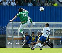 Photo: Andrew Unwin.<br />Northern Ireland v Azerbaijan. FIFA World Cup Qualifying match. 03/09/2005.<br />Northern Ireland's James Quinn (L) flies in on Azerbaijan's Zaur Tagizade (R).