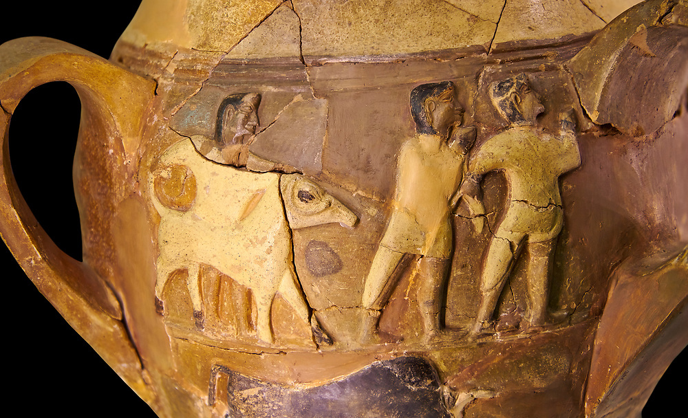 Hüseyindede vases, Old Hittite Polychrome Relief vessel, close up depicting a bull being led to be sacrificed, following Hittite convention of sacrificing an animal of the same gender as the God this bull indicates the sacrifice is to a male god, 16th century BC.. Çorum Archaeological Museum, Corum, Turkey. Against a black bacground. .<br /> <br /> If you prefer to buy from our ALAMY STOCK LIBRARY page at https://www.alamy.com/portfolio/paul-williams-funkystock/hittite-art-antiquities.html  - Huseyindede into the LOWER SEARCH WITHIN GALLERY box. Refine search by adding background colour, place, museum etc<br /> <br /> Visit our HITTITE PHOTO COLLECTIONS for more photos to download or buy as wall art prints https://funkystock.photoshelter.com/gallery-collection/The-Hittites-Art-Artefacts-Antiquities-Historic-Sites-Pictures-Images-of/C0000NUBSMhSc3Oo