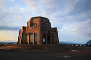 USA, Oregon, Columbia Gorge National Scenic Area, Vista House at sunset. People have gathered to watch the sunset and make photos