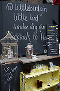 A trendy gin bar chalkboard at Maltby Street Market on 17th October 2015 in London, United Kingdom. Opening in 2010, Maltby Street is an artisan food market under the railways arches in Bermondsey, London.
