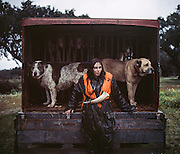 """Ana Parreira, tracking dog handler. <br /> <br /> <br /> """"The Pose and the Prey""""<br /> <br /> Hunting in my imagination was always more like taxidermy — as if the prey was just a mere accessory of the hunter's pose for his heroic photograph — the real trophy.<br /> <br /> When I decided to document the daily lives of Portuguese hunters, I had in my memory the """"cliché"""" from the photographer José Augusto da Cunha Moraes, captured during a hippopotamus hunt in the River Zaire, Angola, and published in 1882 in the album Africa Occidental. The white hunter posed at the center of the photograph, with his rifle, surrounded by the local tribe.<br /> <br /> It was with this cliché in mind that I went to Alentejo, south of Portugal, in search of the contemporary hunters. For several months I saw deer, wild boar, foxes. I photographed popular hunting and private hunting estates, wealthy and middle class hunters, meat hunters and trophy hunters. I photographed those who live from hunting and those who see it as a hobby for a few weekends during the year. I followed the different times and moments of a hunt, in between the prey and the pose, wine and blood, the crack of gunfire and the murmur of the fields .<br /> <br /> I was lucky, I heard lots of hunting stories. I found an essentially old male population, where young people are a minority. Hunters, a threatened species by aging and loss of economic power caused by the crisis in the South of Europe.<br /> <br /> The result of this project is this series of contemporary images, distant from the """"cliche"""" of 1882.<br /> <br /> — Antonio Pedrosa"""