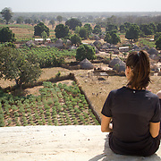 From the top of Koumbadiouma's World Vision-sponsored water tower, Peace Corps volunteer Rachael looks down over the village she's called home for almost two years. Kolda, Senegal.
