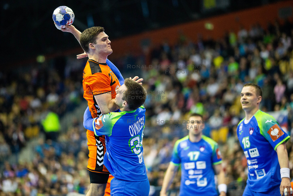 14-04-2019 SLO: Qualification EHF Euro Slovenia - Netherlands, Celje<br /> Kay Smiths of Netherlands vs Rok Ovnicek of Slovenia  during handball match between National teams of Slovenia and Netherlands in Qualifications of 2020 Men's EHF EURO
