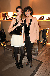 NINE D'URSO and her mother INES DE LA FRESSANGE at a party to celebrate the launch of Miss Viv handbag by Roger Vivier hosted by Ines de la Fressange and Jeanne Marine at the Roger Vivier stoe in Sloane Street, London on 16th March 2010.  Earlier in the day thieves attempted to steal the bags in a smash & grab raid but he bags were recovered and the party went ahead.