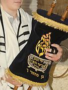 Bar Mitzvah ceremony. Bar Mitzvah boy the Torah scrolls