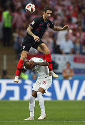 July 11, 2018 - Moscow, Russia - Ashley Young of England is jumped by Sime Vrsaljko of Croatia during the 2018 FIFA World Cup semi-final match between England and Croatia in Moscow, Russia. Croatia 2:1 England. (Credit Image: © Xu Zijian/Xinhua via ZUMA Wire)