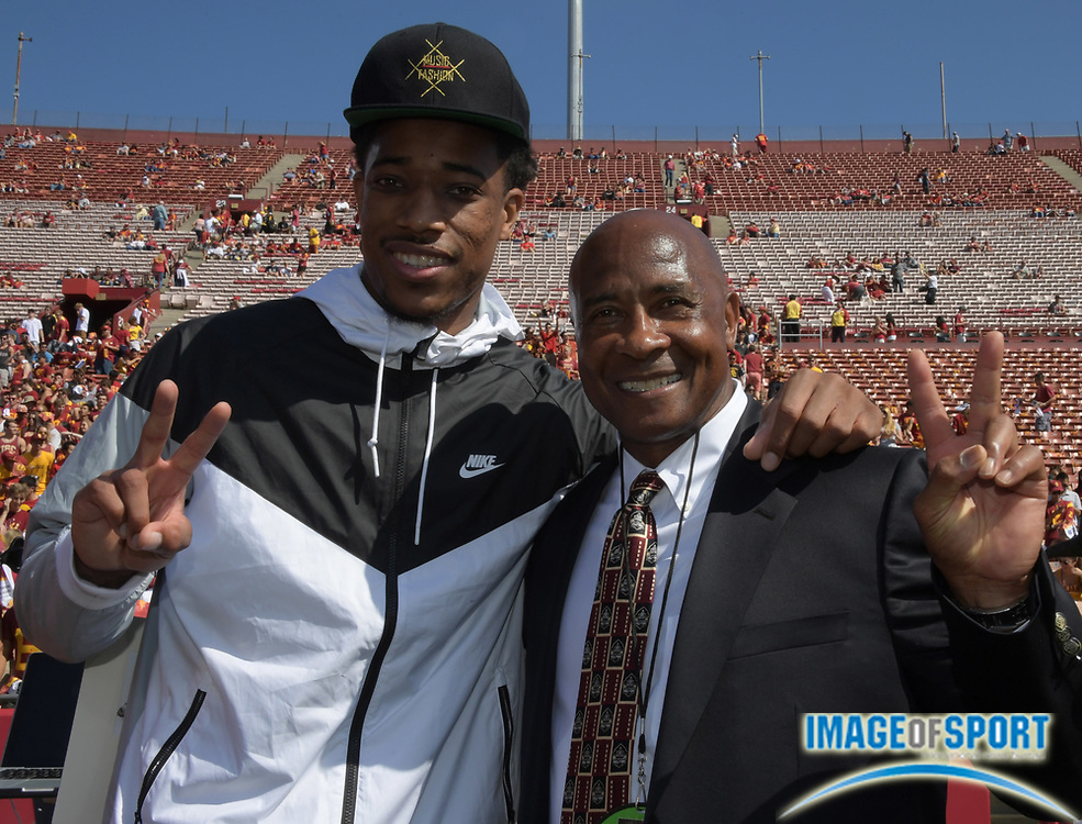 Sep 10, 2016; Los Angeles, CA, USA; Toronto Raptors and USC Trojans former guard DeMar DeRozan (left) poses with USC Trojans athletic director Lynn Swann attend a NCAA football game against the Utah State Aggies at Los Angeles Memorial Coliseum.