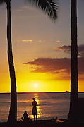 Couple at sunset, Waikiki, Oahu, Hawaii<br />