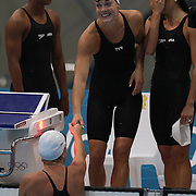 The USA Women's 4 x 100m Freestyle relay team of Lia Neal, Amanda Weir, Natalie Coughlin and Allison Schmitt after qualifying for the final heats during the swimming heats at the Aquatic Centre at Olympic Park, Stratford during the London 2012 Olympic games. London, UK. 28th July 2012. Photo Tim Clayton