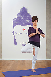 Mature woman portrait fit wellness yoga meditation