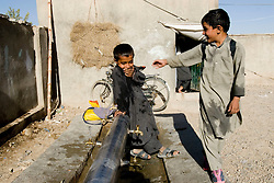 Helmand, 24 Sept. 2006..Young Muslims wash their body, Al-Wudu, before pray in Lashkargah City
