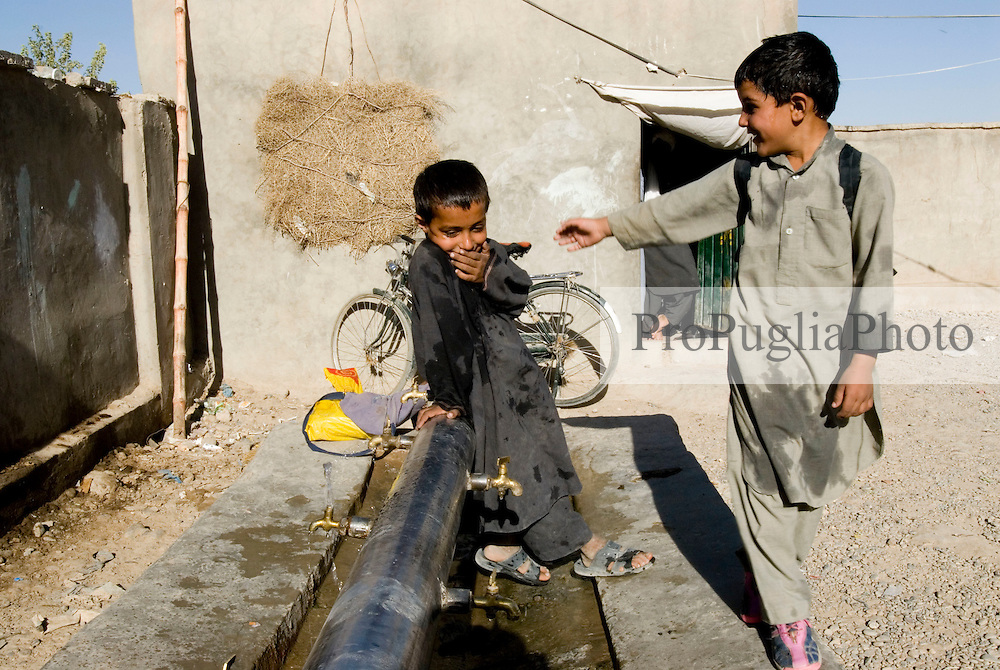 Helmand, 24 Sept. 2006..Young Muslims wash their body, Al-Wudu, before pray in Lashkargah City