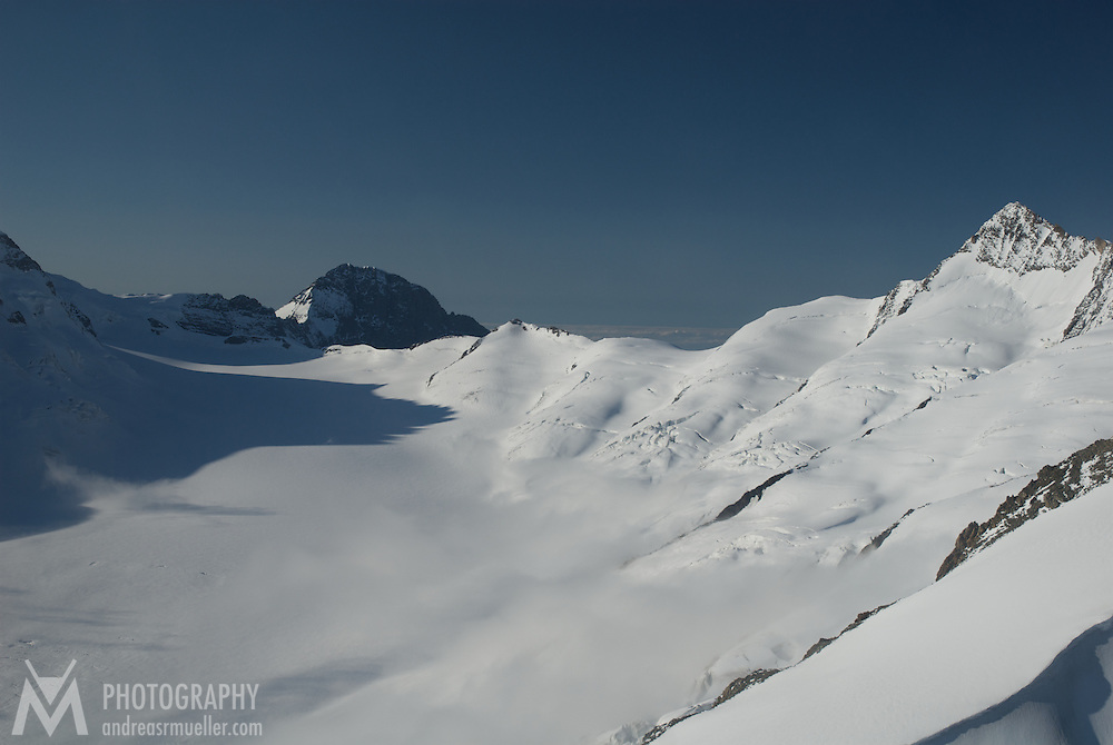 Aerial view of mountains covered by ice and snow.