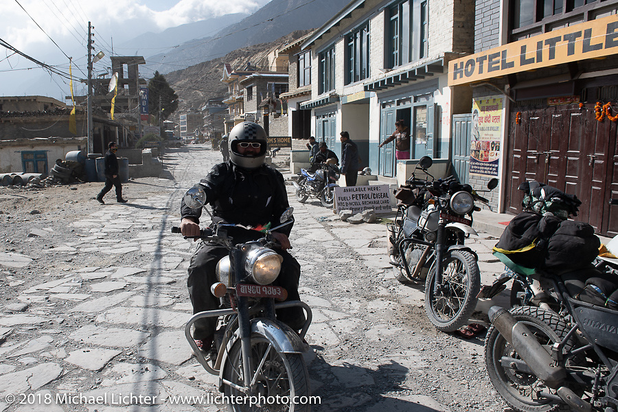 Riding through Jomsom on day-5  of our Himalayan Heroes adventure riding from Kalopani through the Mustang District to our highest elevation of the trip at over 12,000' when we reached Muktinath, Nepal. Saturday, November 10, 2018. Photography ©2018 Michael Lichter.