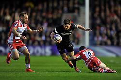 Sam Beard of Edinburgh Rugby is tackled by Greig Laidlaw of Gloucester Rugby - Photo mandatory by-line: Patrick Khachfe/JMP - Mobile: 07966 386802 01/05/2015 - SPORT - RUGBY UNION - London - The Twickenham Stoop - Edinburgh Rugby v Gloucester Rugby - European Rugby Challenge Cup Final