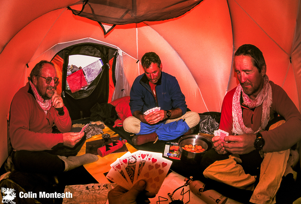 Playing cards during winter ski expedition to K2, Baltoro glacier, Karakoram mountains, Pakistan.