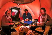 Playing cards during winter ski expedition to K2, Baltoro glacier, Karakoram mountains, Pakistan.