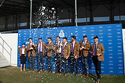 """Henley on Thames, United Kingdom, 8th July 2018, Sunday,  """"Henley Royal Regatta"""",  Temple Challenge Cup, Winners, University of Washington USA, with Trophy, celebrating with burst of champagne, View, Henley Reach, River Thames, Thames Valley, England, UK."""