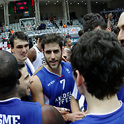 Anadolu Efes's Stratos Perperoglou (C) and Dario Saric (L) celebrate victory during their Turkish basketball league match Besiktas integral Forex between Anadolu Efes at BJK Akatlar Arena in Istanbul, Turkey, Monday, January 05, 2015. Photo by TURKPIX