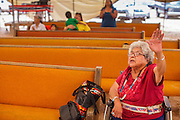 "14 JULY 2012 - FT DEFIANCE, AZ:  Sister ANGIE BOWMAN prays during ""Singspiration"" gospel jam at the 23rd annual Navajo Nation Camp Meeting in Ft. Defiance, north of Window Rock, AZ, on the Navajo reservation. Bowman has been coordinating the camp meeting since its founding 23 years ago. Preachers from across the Navajo Nation, and the western US, come to Navajo Nation Camp Meeting to preach an evangelical form of Christianity. Evangelical Christians make up a growing part of the reservation - there are now more than a hundred camp meetings and tent revivals on the reservation every year. The camp meeting in Ft. Defiance draws nearly 200 people each night of its six day run. Many of the attendees convert to evangelical Christianity from traditional Navajo beliefs, Catholicism or Mormonism. ""Camp meetings"" are a form of Protestant Christian religious services originating in Britain and once common in rural parts of the United States. People would travel a great distance to a particular site to camp out, listen to itinerant preachers, and pray. This suited the rural life, before cars and highways were common, because rural areas often lacked traditional churches.PHOTO BY JACK KURTZ"