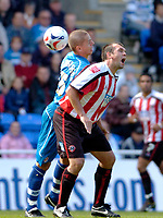 Photo: Leigh Quinnell.<br /> Reading v Sheffield United. Coca Cola Championship.<br /> 01/10/2005. Sheffield Uniteds Neil Shipperley feels the force of Readings Ivar ingimarsson.