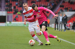 Michael Smith of Peterborough United battles with Luke McCullough of Doncaster - Mandatory byline: Joe Dent/JMP - 19/03/2016 - FOOTBALL - The Keepmoat Stadium - Doncaster, England - Doncaster Rovers v Peterborough United - Sky Bet League One