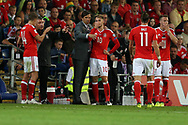 Chris Coleman, the Wales manager gives instructions to Aaron Ramsey (10) of Wales during a break in play. Wales v Austria , FIFA World Cup qualifier , European group D match at the Cardiff city Stadium in Cardiff , South Wales on Saturday 2nd September 2017. pic by Andrew Orchard, Andrew Orchard sports photography