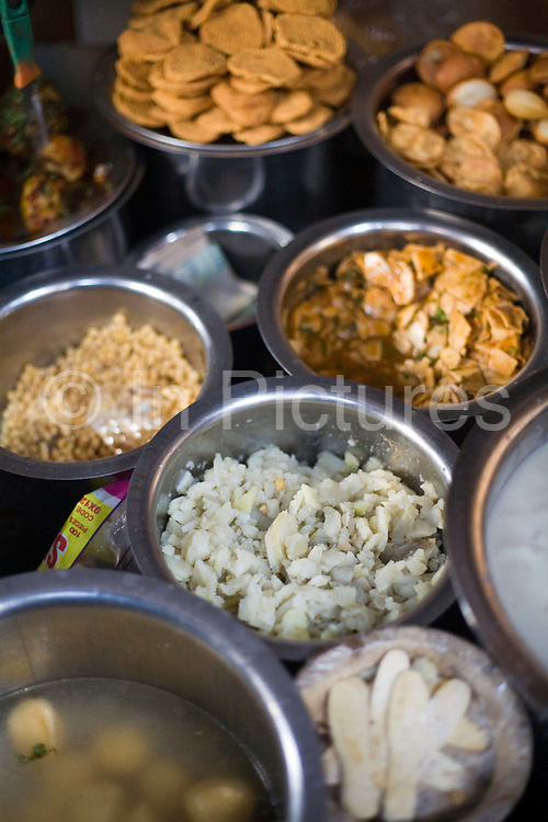 Pots of chat (street food snacks) at the Ashok Chat Corner in Chawri Bazaar, Old Delhi India