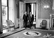 On a state visit to Dublin, French President Francois Mitterand paid a visit to Áras an Uachtaráin, where he was greeted by Irish President Patrick Hillery. Here President Hillery leads President Mitterand into the drawing room at the Áras.<br /> 21 February 1984