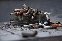 Ashtray overflowing with cigarette butts, Munich, Bavaria, Germany