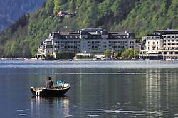 THEMENBILD - ein Fischer in seinem Ruderboot im Zeller See, aufgenommen am 19. Mai 2019, Zell am See, Österreich // a fisherman in his rowing boat in the Zeller lake on 2019/05/19, Zell am See, Austria. EXPA Pictures © 2019, PhotoCredit: EXPA/ Stefanie Oberhauser