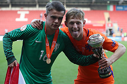 Netherlands goalkeeper Joey Koorevaar (left) and Wouter Burger celebrate with the trophy during the UEFA European U17 Championship final at the AESSEAL New York Stadium, Rotherham.